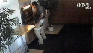 guy-caught-on-camera-with-his-pants-down-while-using-atm